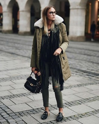 How to wear: olive parka, black fringe open cardigan, black long sleeve t-shirt, olive ripped skinny jeans