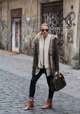How to wear: olive parka, beige knit open cardigan, navy skinny jeans, tobacco leather ankle boots