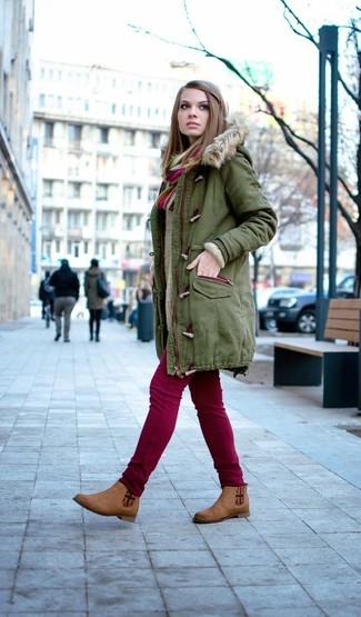 If you love staying-in clothes which are stylish enough to wear out, consider this combination of an olive parka and a multi colored scarf. Round off with brown suede chelsea boots and off you go looking stunning. This combination is a striking example that you don't have to give up style for functionality during winter.