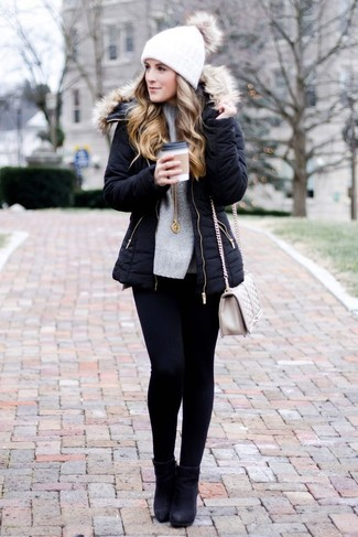 How to wear: black parka, grey knit oversized sweater, black skinny jeans, black leather ankle boots