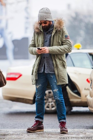 Choose a parka and blue distressed jeans for a laid-back yet fashion-forward outfit. Finish off this look with dark red leather work boots.