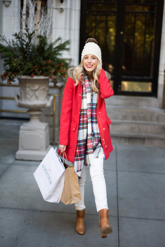 How to wear: red parka, white skinny jeans, tan leather ankle boots, white beanie