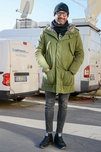 Men's Looks & Outfits: What To Wear In Winter: Try pairing an olive parka with grey ripped skinny jeans to feel infinitely confident and look trendy. Get a bit experimental when it comes to shoes and complete your outfit with black leather low top sneakers. In the colder months, when warmth is everything, it can be easy to settle for a less-than-stylish look. But this look is a clear example that you totally can stay comfy and remain stylish in the colder months.
