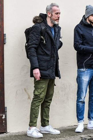 How to wear: black parka, blue sweatshirt, olive cargo pants, white leather low top sneakers