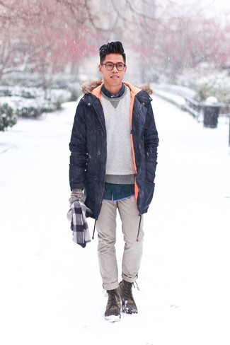 How to Wear a Grey Sweatshirt For Men: Go for a pared down yet neat and relaxed choice marrying a grey sweatshirt and grey chinos. For something more on the daring side to finish this outfit, introduce a pair of olive snow boots to the mix.