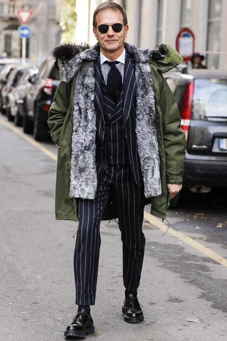 How to wear: olive parka, black vertical striped three piece suit, white and black vertical striped dress shirt, black leather oxford shoes