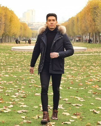 Work Boots Outfits For Men: This casual combination of a black parka and black skinny jeans is a foolproof option when you need to look cool but have no time to spare. Now all you need is a pair of work boots to complete this ensemble.
