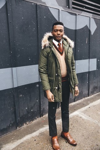 How to Wear Orange Socks For Men: An olive parka and orange socks are an edgy combo that every trendsetting gentleman should have in his off-duty arsenal. You know how to infuse an element of sophistication into this outfit: brown leather loafers.