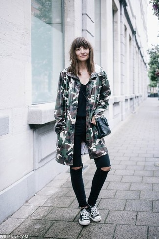 How to wear: dark green camouflage parka, black v-neck t-shirt, black ripped skinny jeans, black and white canvas low top sneakers