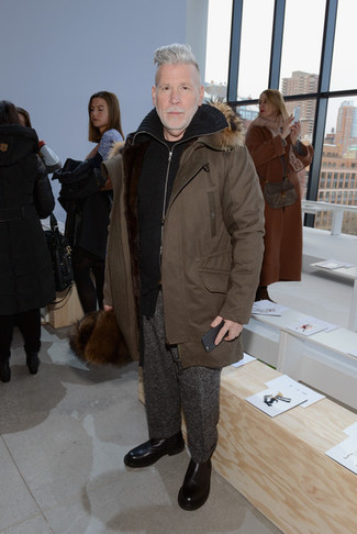 Nick Wooster wearing Brown Parka, Black Zip Sweater, Black Crew-neck T-shirt, Charcoal Wool Dress Pants