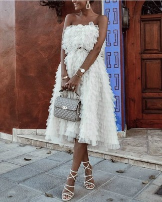 Go for a sophisticated look in a white tulle party dress and a gold bracelet. A pair of white leather gladiator sandals ads edginess to a femme classic. Needless to say, it's easier to work through a hot summertime afternoon in a easy and breezy ensemble such as this one.