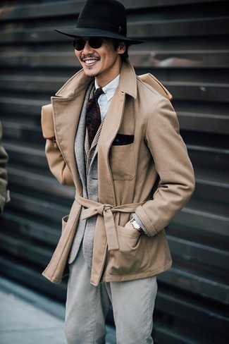 A modern man's sophisticated closet should always include such stylish essentials as a tan pea coat and a navy polka dot pocket square. You can bet this combination is great when the cold days hit.