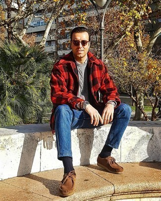 Brown Suede Desert Boots Outfits: Go for a red and black gingham pea coat and blue jeans to put together an interesting and modern-looking outfit. A good pair of brown suede desert boots pulls this ensemble together.