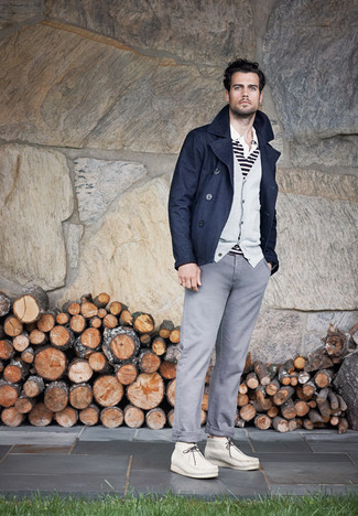 How to wear: navy pea coat, grey cardigan, white and black horizontal striped polo, grey chinos