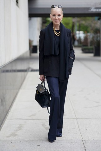 How to wear: black pea coat, black crew-neck sweater, navy dress pants, black leather ankle boots