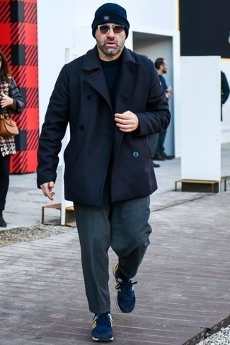 How to Wear a Navy Crew-neck Sweater For Men: Choose a navy crew-neck sweater and charcoal dress pants and you're bound to make heads turn. If you want to instantly dial down this getup with footwear, complete your ensemble with navy athletic shoes.