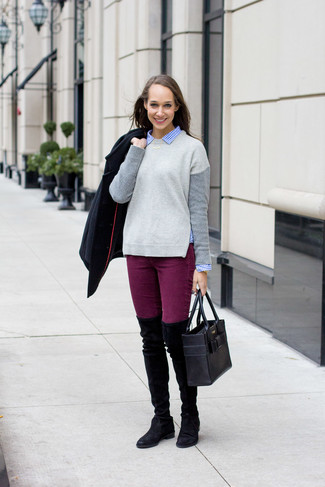 Purple Jeans Outfits For Women: This casual combination of a black pea coat and purple jeans is capable of taking on different moods depending on the way you style it. On the shoe front, this look is rounded off nicely with black suede over the knee boots.