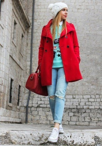 Who said you can't make a style statement with a casual look? Draw the attention in a red pea coat and light blue ripped skinny jeans. For something more on the daring side to complement this look, rock a pair of white canvas low top sneakers. This combo is perfect for summer-to-fall weather.
