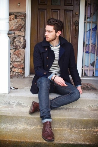 A navy blue pea coat and dark blue jeans are a great outfit formula to have in your arsenal. Dark brown leather desert boots are a good choice to complete the look.
