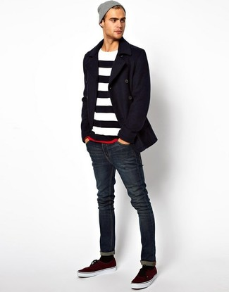 How to wear: navy pea coat, white and navy horizontal striped crew-neck sweater, navy skinny jeans, burgundy plimsolls
