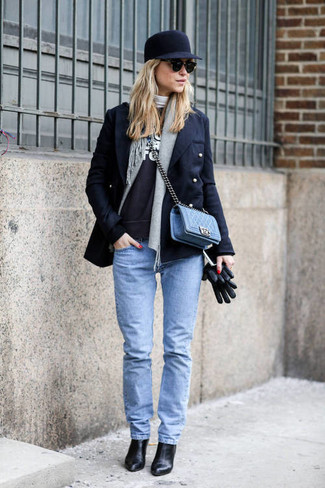 If you're a fan of classic pairings, then you'll like this combination of a black pea coat and baby blue slim jeans. Black leather booties will bring a classic aesthetic to the ensemble.