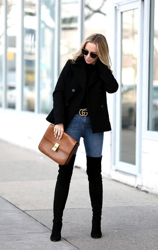How to wear: black pea coat, black crew-neck sweater, blue skinny jeans, black suede over the knee boots