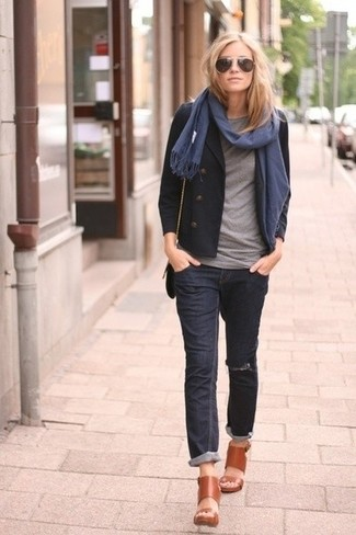 Nail glam in a black pea coat and a navy and white scarf. Cognac leather heeled sandals will become an ideal companion to your style. A comfortable transition getup like this one makes it very easy to embrace the new season.