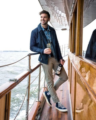 How to wear: navy pea coat, blue denim jacket, navy crew-neck sweater, beige chinos