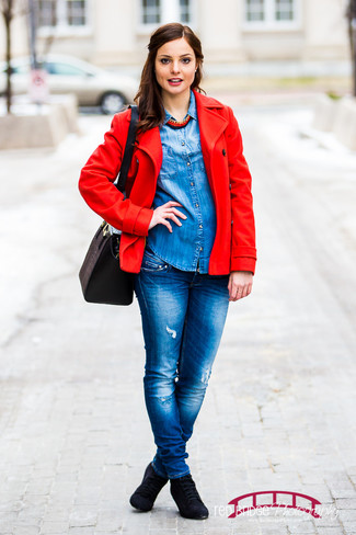 A red peacoat with blue destroyed jeans has become an essential combination for many style-conscious girls. This outfit is complemented perfectly with black suede lace-up ankle boots.
