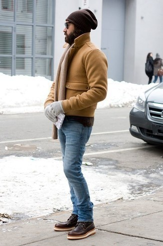 Men's Looks & Outfits: What To Wear In Winter: This combo of a tan pea coat and light blue jeans is a safe option when you need to look effortlessly sleek in a flash. A pair of dark brown leather casual boots looks wonderful finishing this look. During the winter season, when warmth is key, it can be easy to settle for a less-than-stylish outfit in the name of convenience. However, this outfit is a stark illustration that you can actually stay toasty and remain equally stylish in the winter season.