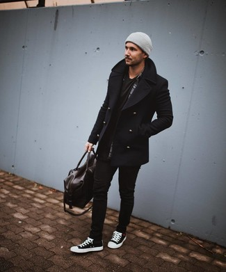 How to Wear a Brown Leather Holdall In Cold Weather Casually For Men: Such essentials as a black pea coat and a brown leather holdall are an easy way to introduce played down dapperness into your day-to-day styling routine. Let your sartorial savvy really shine by completing your outfit with a pair of black and white canvas high top sneakers.