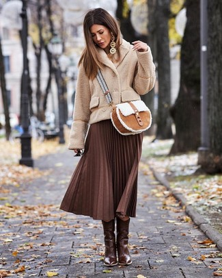 Dark Brown Leather Cowboy Boots Outfits For Women: For a laid-back outfit, consider teaming a beige fleece pea coat with a dark brown pleated midi skirt — these pieces work beautifully together. You can get a bit experimental when it comes to footwear and complete your ensemble with dark brown leather cowboy boots.