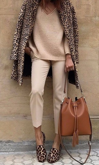 How to wear: tan leopard pea coat, tan knit oversized sweater, beige tapered pants, brown leopard calf hair loafers