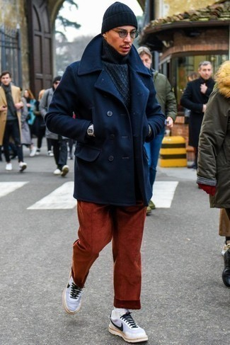 Navy Beanie Outfits For Men: A navy pea coat and a navy beanie are the ideal way to infuse extra cool into your daily off-duty arsenal. Go ahead and add a pair of white and black athletic shoes to the equation for a more laid-back twist.