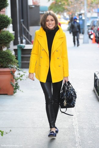 How to wear: yellow pea coat, black knit turtleneck, black leather leggings, navy embroidered suede loafers