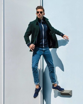 How to wear: dark green pea coat, navy zip sweater, blue jeans, navy canvas low top sneakers