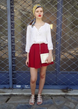 Try teaming a peasant blouse with an oxblood skater skirt to get a laid-back yet stylish look. This outfit is complemented perfectly with white leather gladiator sandals.