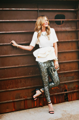 Silver Sequin Skinny Pants Outfits: Wear a white peplum top with silver sequin skinny pants for an effortless kind of class. All you need is a pair of black leather heeled sandals to finish off this look.
