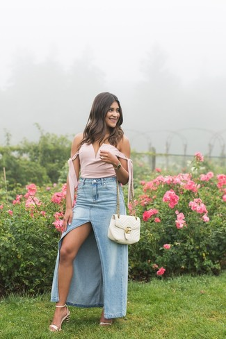 How to wear: pink bustier top, light blue slit denim maxi skirt, pink leather heeled sandals, white quilted leather satchel bag