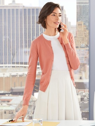How to wear: pink cardigan, white short sleeve sweater, white full skirt