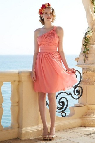 A pink chiffon party dress and a headband are a nice combination that will earn you the proper amount of attention. For the maximum chicness go for a pair of tan leather heeled sandals. A killer combo like this one is just what you need when summer days set in.