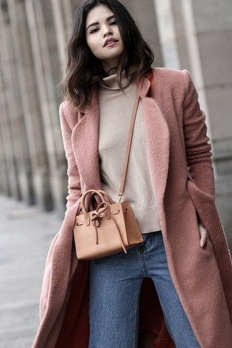 How to wear: pink coat, beige turtleneck, blue jeans, tan leather crossbody bag