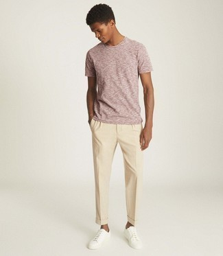 Pink Crew-neck T-shirt Outfits For Men: You'll be amazed at how extremely easy it is for any gentleman to throw together this laid-back outfit. Just a pink crew-neck t-shirt worn with beige chinos. A pair of white leather low top sneakers will be a stylish addition to this ensemble.