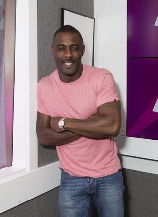 Idris Elba wearing Pink Crew-neck T-shirt, Blue Jeans, Silver Watch