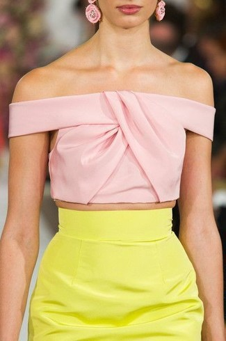 Yellow Pencil Skirt Outfits: Pair a pink cropped top with a yellow pencil skirt for a comfy getup that's also put together.