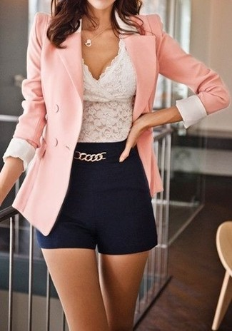 This combo of a dusty pink double breasted blazer and black shorts is a safe bet for an effortlessly cool look.