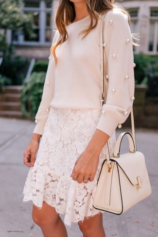 How to wear: pink embellished crew-neck sweater, white lace mini skirt, white leather satchel bag