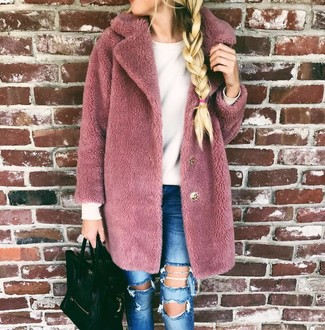 How to wear: pink fur coat, white crew-neck sweater, blue ripped skinny jeans, black leather tote bag