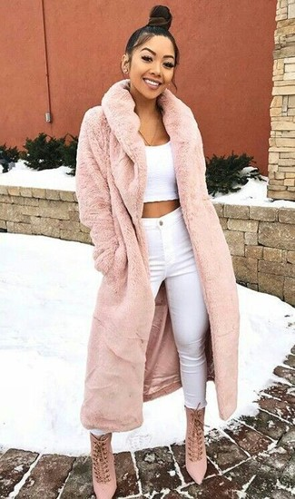 How to wear: pink fur coat, white cropped top, white skinny jeans, pink suede lace-up ankle boots