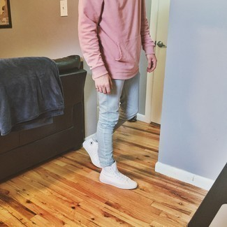 Light Blue Jeans Outfits For Men: If you love classic combinations, then you'll love this combination of a pink hoodie and light blue jeans. Take a more casual route when it comes to footwear by rocking a pair of white canvas high top sneakers.